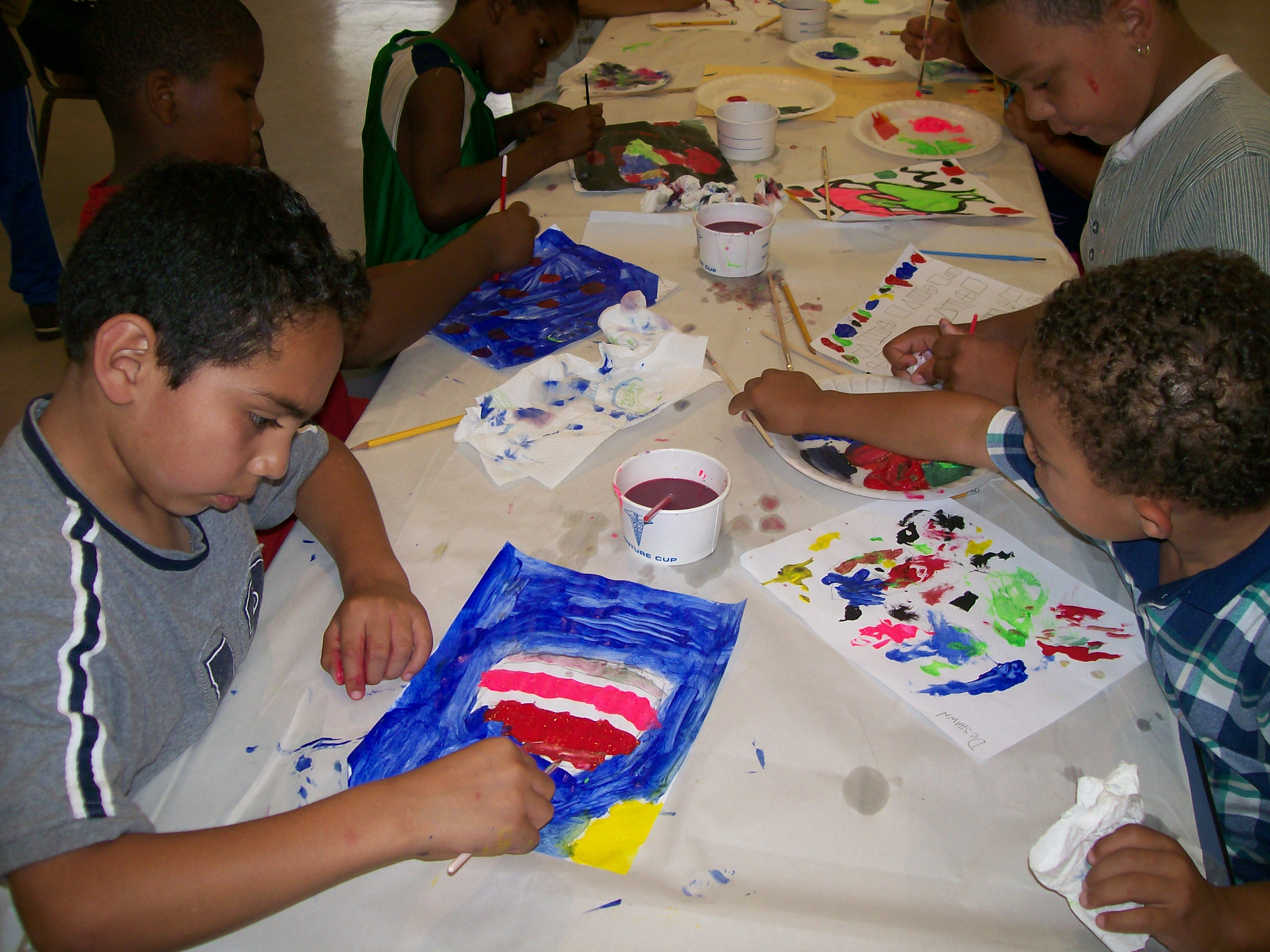 Children enjoy arts and crafts at the Pigeon Community Multicultural Development Center.
